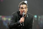 Robbie Williams breekt arm van fan tijdens concert